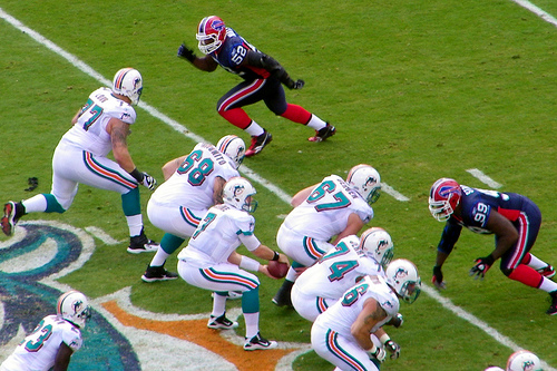 Bills Defenders rushing the Miami Dolphins pass protection